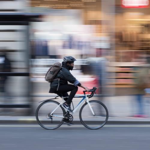 person riding a bike fast