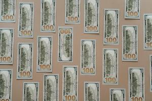 hundred dollar bills representing car accident damages