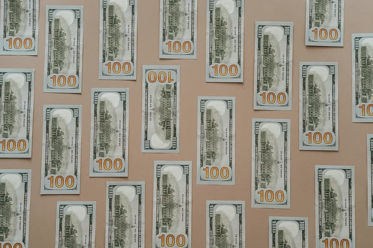 hundred dollar bills representing car accident damages