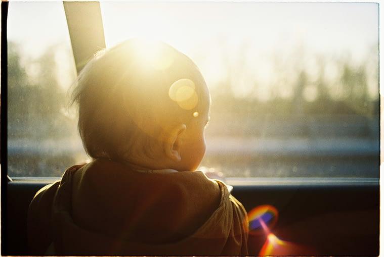 baby in hot car looking through window