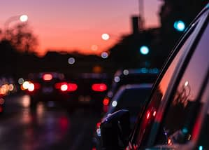cars on the road in sunset